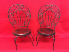 Two hand-made chairs in wood and iron-second half of the 20th century