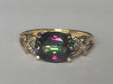 Gold ring with a mystic topaz