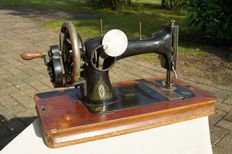 Antique Veritas Sewing machine with wooden cover, approx. 1900