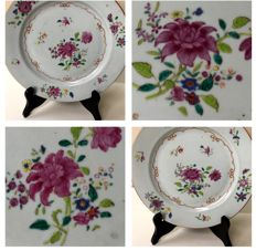 A set of matching Famille Rose hand painted saucers with flowers - China - famille rose - 18th century.
