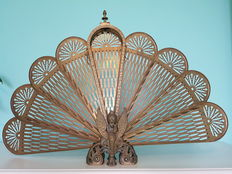 Fanned fireplace screen of bronze with brass, circa 1920