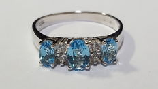 Trilogy ring with sky-blue and white topaz