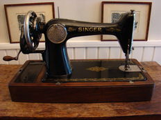 Singer 15K sewing machine of an original wooden dust cover with handle, 1927