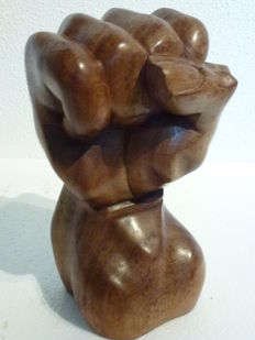 Solid hand-carved wooden fist