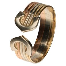 14 kt tricolour gold ring of 14 kt.