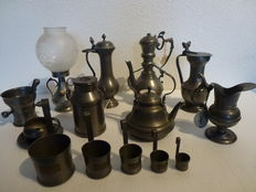 Collection of 14 Dutch, handmade pewter jugs, oil lamp, Cup and saucer mortar Kettle etc