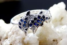 White gold dolphin ring with sapphires
