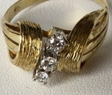 14 kt Yellow gold ring with three very beautiful brilliant cut natural diamonds. Excellent condition.