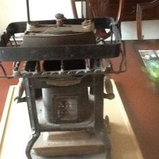 A very old ironing machine