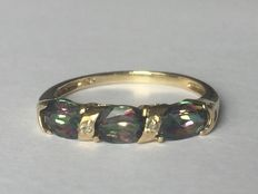 Gold ring with 3x Mystic topaz