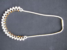 Ivory necklace with tiger's eye beads.
