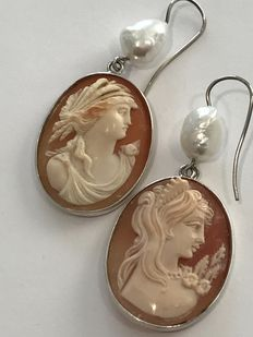 Sterling silver earrings with cameos and pearls.