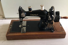 Very fine Schurhoff manual sewing machine with wooden cover, Germany, mid 20th century