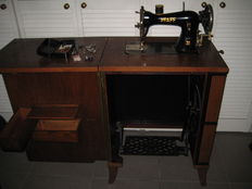 Pfaff - Unique pedal sewing machine in a decorative cabinet, Germany, first half of the 20th century
