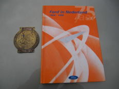 Old rare emblem Ford factory and book 75 jaar Ford in Nederland