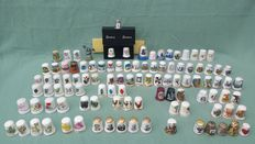 Collection of 104 thimbles.