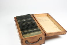 Glass plate negatives in wooden storage chest