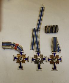 WW2. three German Awards: 3 German mother crosses in gold, silver and bronze and a corresponding Spange.