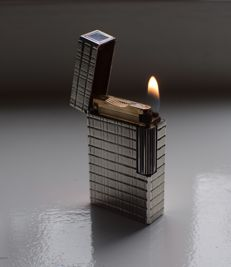 S.T. Dupont - silver plated Ligne 1 lighter with vertical motif - 1970s/1980s