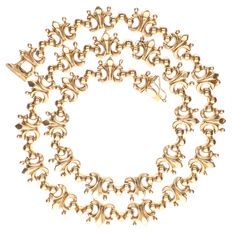 18 kt yellow gold necklace with French lily link pattern