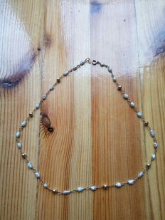 Pearl Necklace With 14k Gold Beads ; The length is 40 cm.