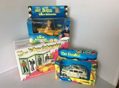 The Beatles 3 collectors items. : Corgi Die cast model of the yellow Submarine., Plastic model kit of the yellow Submarine., Corgi Die cast model of the newspaper taxi cab.
