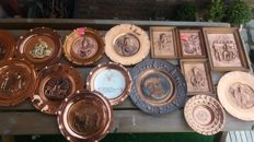 Collection of 15 varnished decorative red copper plates and frames, France ca. 1960