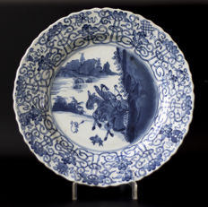 A large blue and white plate hunting scene, Chenghua mark - China - Kangxi c. 1700