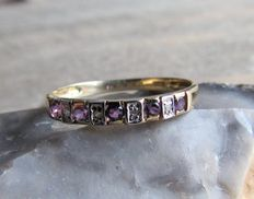 Yellow nd white gold ring with diamonds and amethyst.