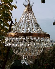 A brass and crystal chandelier , of recent manufacture