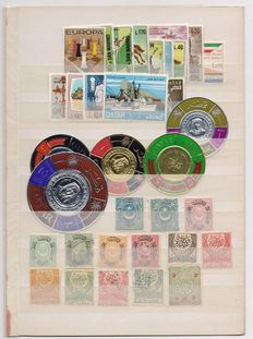 Album with new stamps from all over the world from 1870 to 1960 – Spain, Italy, Qatar, Portugal, English and French colonies, Monaco, Greece, Japan, etc.