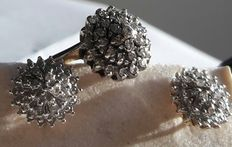 A set comprising of a pair of diamond cluster earrings in white gold with matching ring
