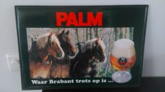 Advertising sign Palm beer.