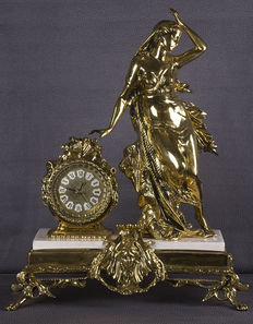 Beautiful solid bronze table clock and marble pedestal.