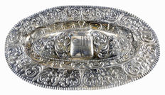 Decorative oval plate, embossed, silver. 19th Century.