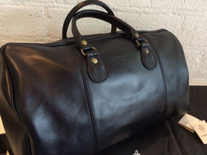 b4c49e235dd89 I Medici Firenze – Leather travel bag with dust bag and tags - Catawiki