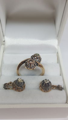 Earrings are 14 kt yellow gold plus a ring set with rose diamond