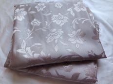 Elegant taupe damask fabric decorated withsilver thread