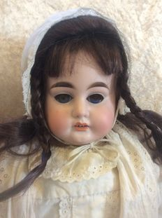 German doll marked: 3200 A M 5 DEP Bisque head, shoulder piece and forearms leather body