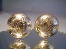 Large silver stud earrings with hand engraving and partial gilt.