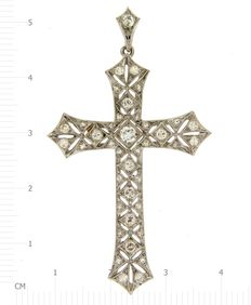 Florentine openwork cross with diamonds.