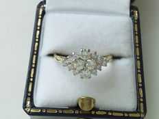 Engagement ring made 18 kt yellow and white gold, with 4 diamonds of 0.10 ct and 10 diamonds of 0.02 ct, totalling 0.60 ct.