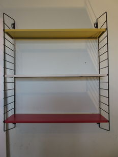 A. Dekker by Tomado - pocket bookshelf/wall rack in the authentic colours.