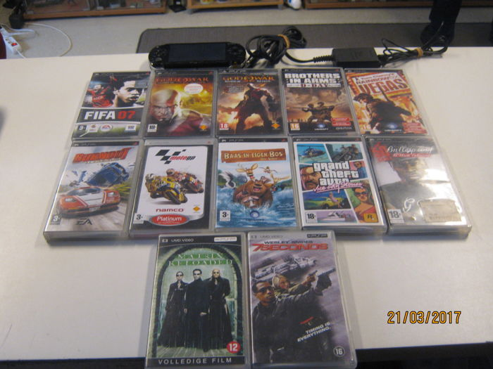 Sony PSP Incl 4 Gb Memory Card 10 Games And 2 Umd Movies