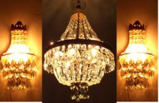 A brass and crystal chandelier and a pair of brass and crystal wall appliques, of recent manufacture