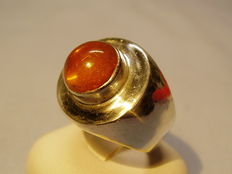 Designer ring with amber cabochon