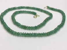 Emerald and 18 kt gold necklace