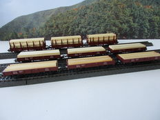 Märklin H0 -4423/4459 - 3 stake carriages and 6 low side carriages, all loaded with wood