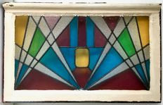 Large art deco stained glass window with modernist decor