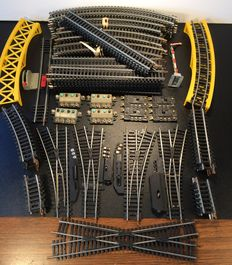 Lima H0 - Large  set rails, 108 pieces with 3 electric switches, 1 manual switch, control consoles, lots of curves and straight pieces, crossings, etc. etc.